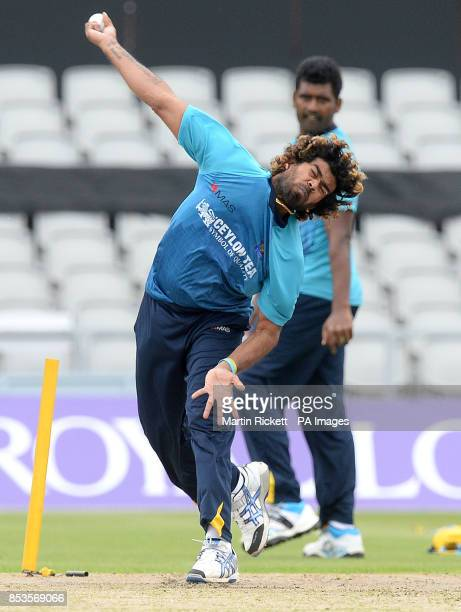 Sri Lanka's Lasith Malinga with Thisara Perera during the nets practice session at Old Trafford Cricket Ground Manchester