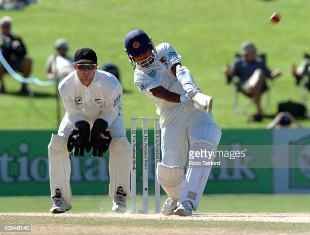 Sri Lanka's Mahela Jayawardena launches into a six in front of the New Zealand wicket keeper Brendon McCullum on the fourth day in the first cricket...