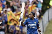 Sri Lanka's Mahela Jayawardene celebrates his century during the first one day international cricket match between New Zealand and Sri Lanka at the...