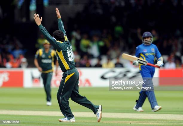 Sri Lanka's Mahela jayawardene leaves the field after he is caught by Shahid Afridi off the bowling of Saeed Amjal during the ICC World Twenty20...