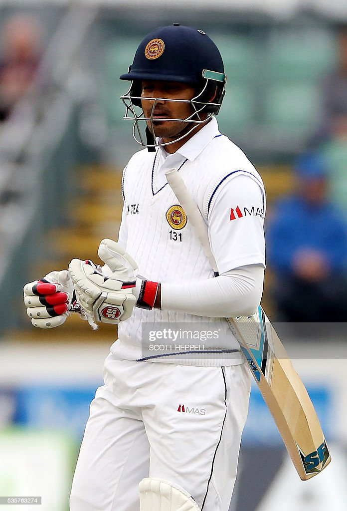 Sri Lanka's Milinda Siriwardana leaves the field after losing his wicket for 35 runs on the fourth day of the second test cricket match between England and Sri Lanka at the Riverside in Chester-le-Street, north east England, on May 30, 2016. / AFP / SCOTT