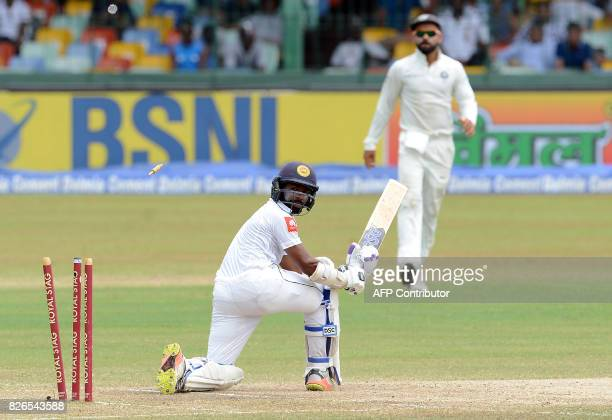 Sri Lanka's Niroshan Dickwella gets dismissed by India's Mohammed Shami during the third day of the second Test cricket match between Sri Lanka and...