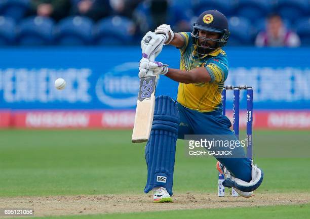 Sri Lanka's Niroshan Dickwella plays a shot during the ICC Champions Trophy match between Sri Lanka and Pakistan in Cardiff on June 12 2017 / AFP...