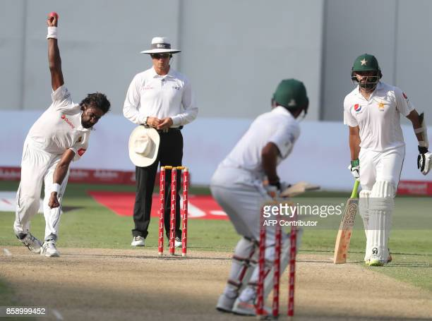 TOPSHOT Sri Lanka's Numan Pradeep bowls during the third day of the second Test cricket match between Sri Lanka and Pakistan at Dubai International...