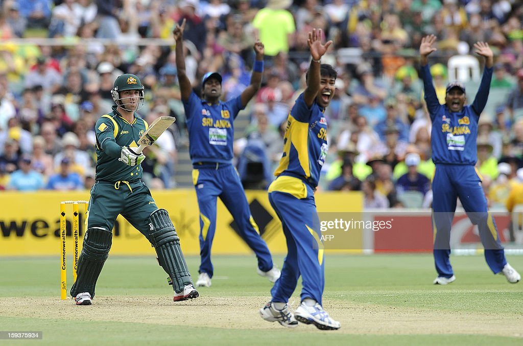 Sri Lanka's Nuwan Kulasekara (2nd R) celebrates as he dismisses Australia's batsman Phillip Hughes (L) during their one-day international cricket match at the Adelaide Oval on January 13, 2013. AFP PHOTO / David Mariuz USE