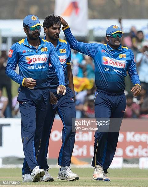 Sri Lanka's Nuwan Pradeep celebrates with his teammates after he dismissed Zimbabwe's Solomon Mire during the second oneday internationals cricket...