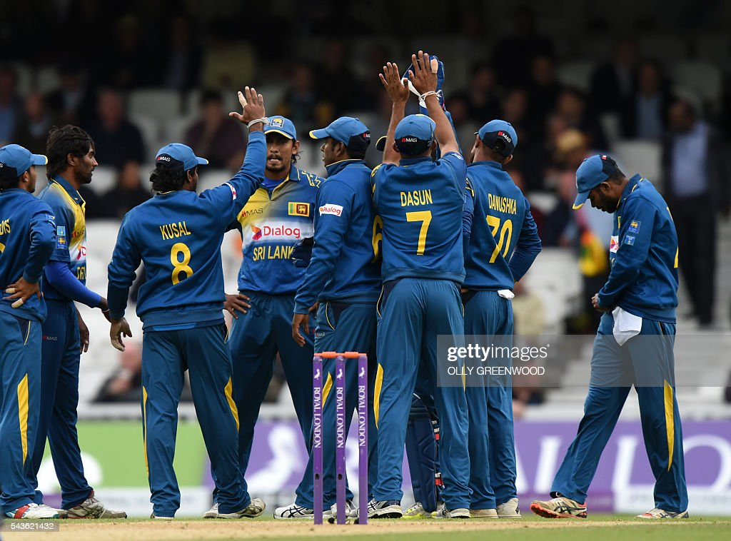 Sri Lanka's players celebrate after taking the wicket of England's Moeen Ali (not pictured) during play in the fourth One Day International (ODI) cricket match between England and Sri Lanka at The Oval cricket ground in London on June 29, 2016. England's victory target was revised to 308 off 42 overs due to the weather having seen the tourists show real guile and style in their innings. ECB