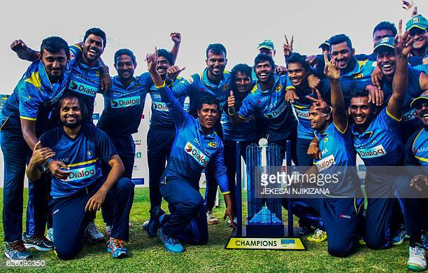 Sri Lanka's players celebrate victory after the final of the Blue Mountain Achilleion triseries played between Sri Lanka and hosts Zimbabwe at the...
