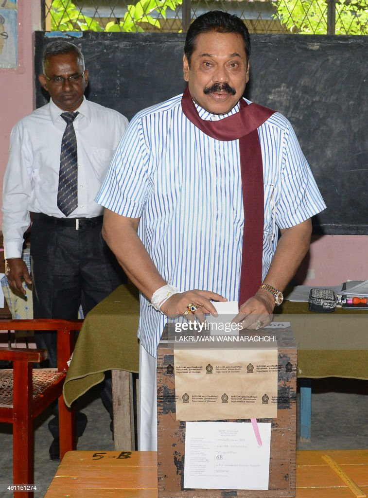 Sri Lanka's President and candidate Mahinda Rajapakse casts his ballot at a polling station in his native town of Tangalla, about 195 kms from the capital Colombo on January 8, 2015. Sri Lanka went to the polls on January 8 in its tightest election in decades, with its strongman president battling for survival after accusations of corruption and a failure to bring about national reconciliation. AFP PHOTO / LAKRUWAN WANNIARACHCHI