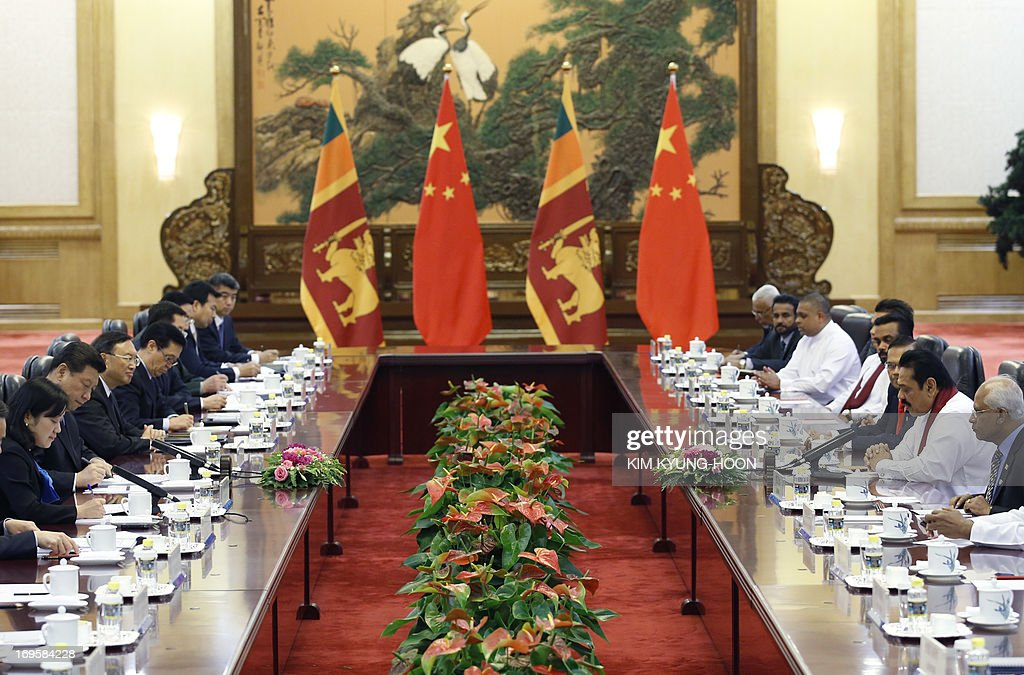 Sri Lanka's President Mahinda Rajapaksa (2nd R) attends a meeting with China's President Xi Jinping (2nd L) at the Great Hall of the People in Beijing on May 28, 2013.