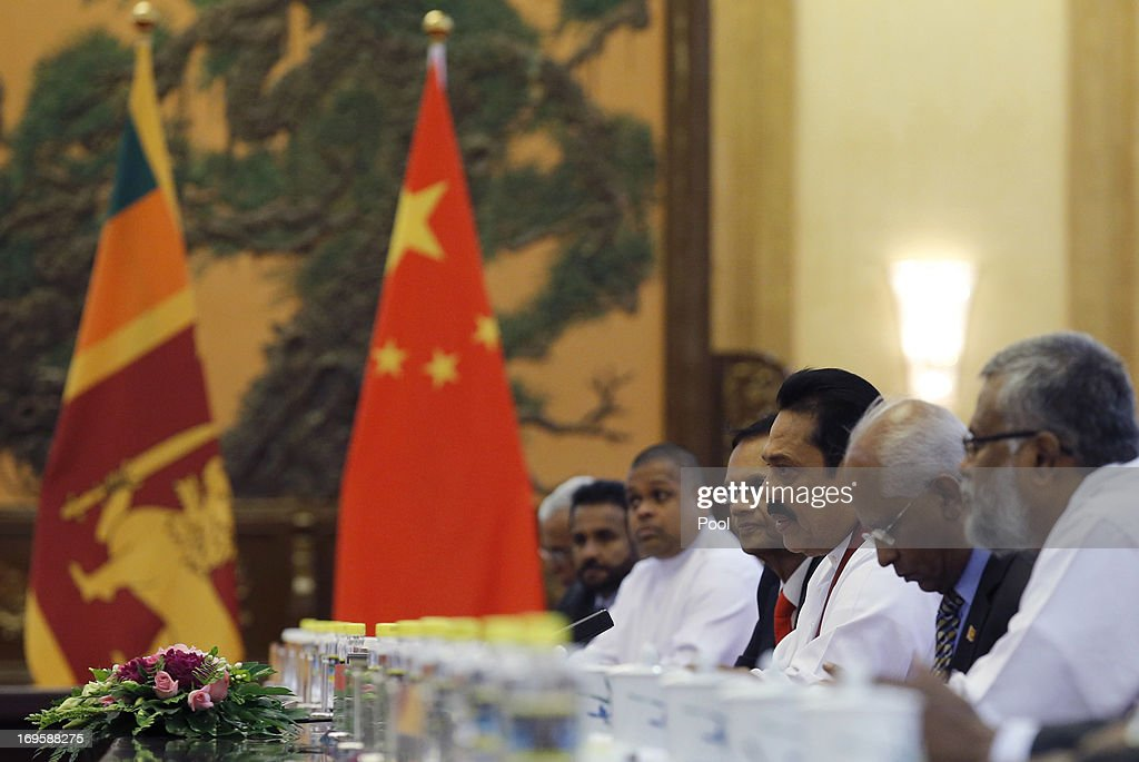 Sri Lanka's President Mahinda Rajapaksa (3rd R) attends a meeting with China's President Xi Jinping (not pictured) at the Great Hall of the People on May 28, 2013 in Beijing, China.