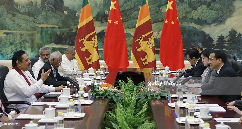 Sri Lanka's President Mahinda Rajapaksa (L) attends a meeting with China's Premier Li Keqiang (R ) at the Great Hall of the People on May 29, 2013 in Beijing, China.