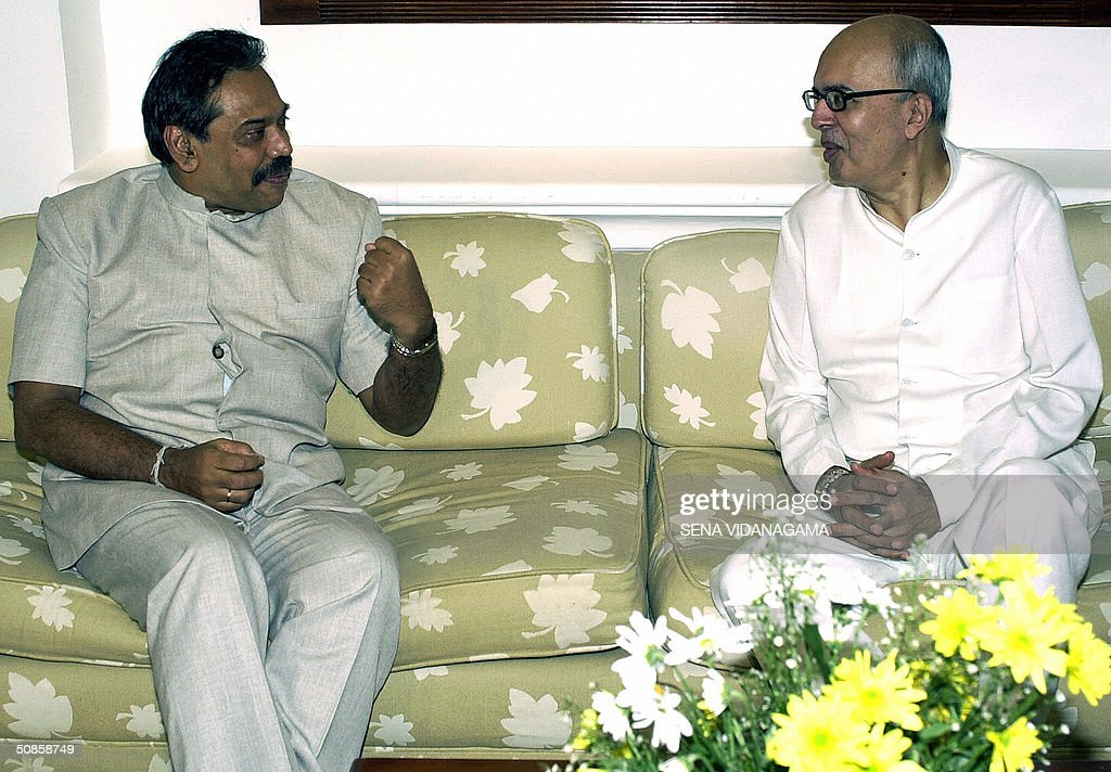 Sri Lanka's Prime Minister Mahinda Rajapakse (L) gestures as he speaks with Indian envoy, Nirupam Sen at his official residence in Colombo, 20 May 2004. Sri Lanka is seeking support from other Test cricket playing nations in the region to defend bowler Muttiah Muralitharan who has set a world record for the highest number of Test wickets and may have his unique 'Doosra' deivery banned by the sport's governing body. AFP PHOTO/Sena VIDANAGAMA