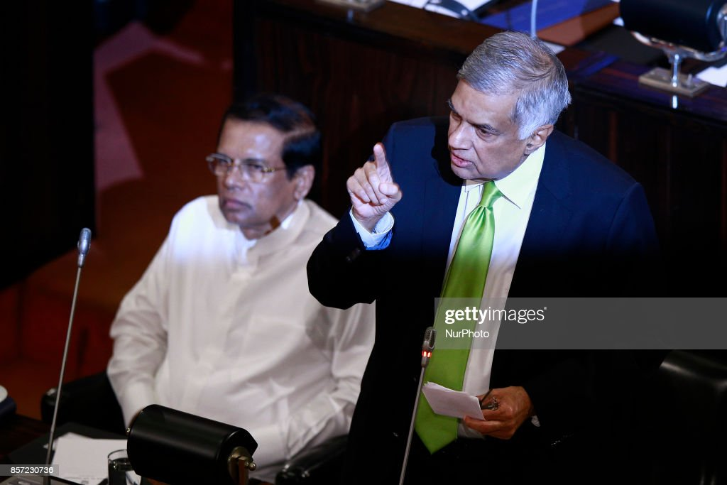 Sri Lanka's Prime Minister Ranil Wickremesinghe (right) delivers a speech as President Maithripala Sirisena (left) looks on during a special sitting of parliament held to commemorate the country's 70th anniversary of the first Parliament of an independent Sri Lanka at Colombo, Sri Lanka on Tuesday 3rd October 2017.