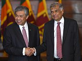Sri Lankas Prime Minister Ranil Wickremesinghe shakes hands with Malaysian Deputy Prime Minister Ahmed Zahid Hamidi ahead of a meeting in Colombo on...