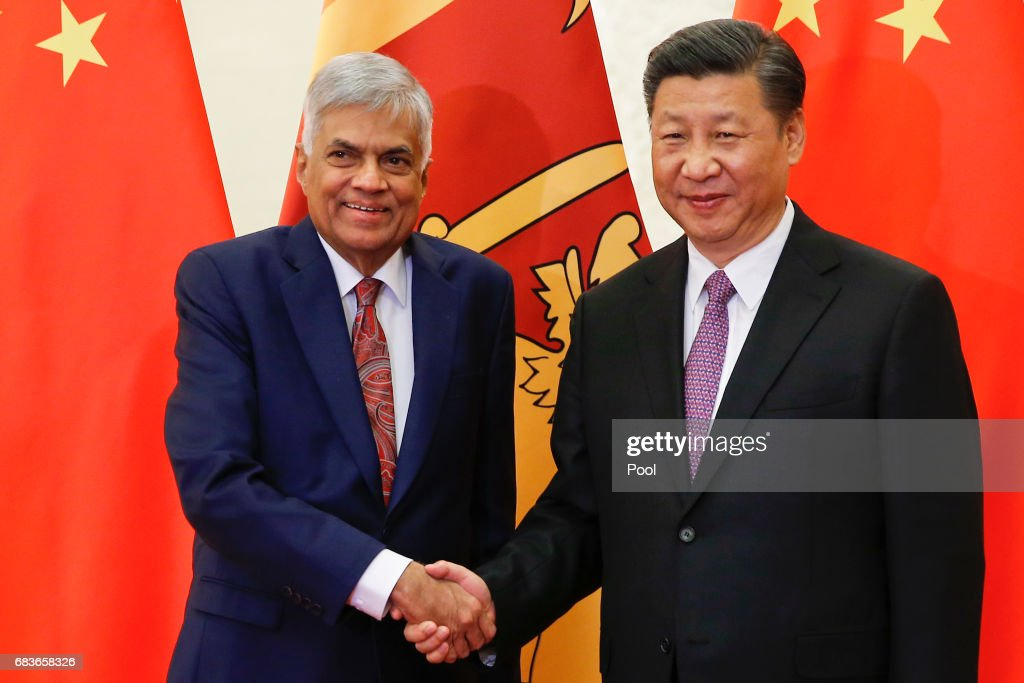 Sri Lanka's Prime Minister Ranil Wickremesinghe shakes hands with Chinese President Xi Jinping as they meet at the Great Hall of the People on May 16, 2017 in Beijing, China.
