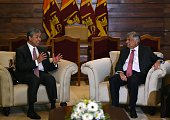 Sri Lankas Prime Minister Ranil Wickremesinghe speaks with Malaysian Deputy Prime Minister Ahmed Zahid Hamidi ahead of a meeting in Colombo on July...
