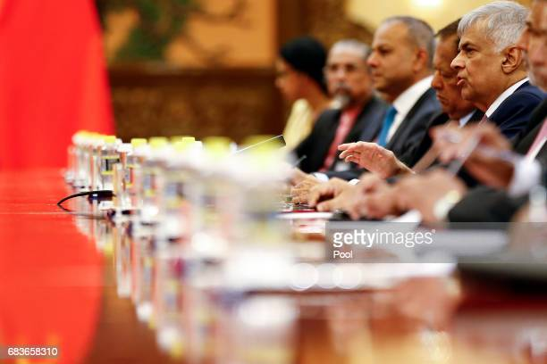 Sri Lanka's Prime Minister Ranil Wickremesinghe talsk to Chinese President Xi Jinping as they meet at the Great Hall of the People on May 16 2017 in...