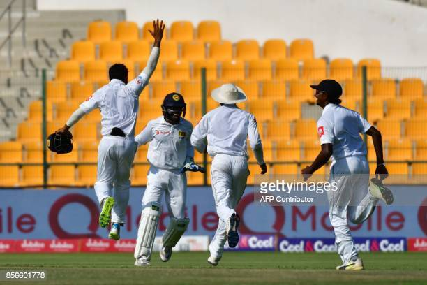 Sri Lanka's Rangana Herath celebrates after he dismissed Pakistan's Sarfraz Ahmed during the fifth day of the first Test cricket match between Sri...