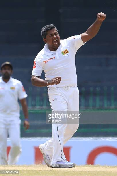 Sri Lanka's Rangana Herath celebrates taking the wicket of Zimbabwe's Hamilton Masakadza during the third day's play of the only test cricket match...