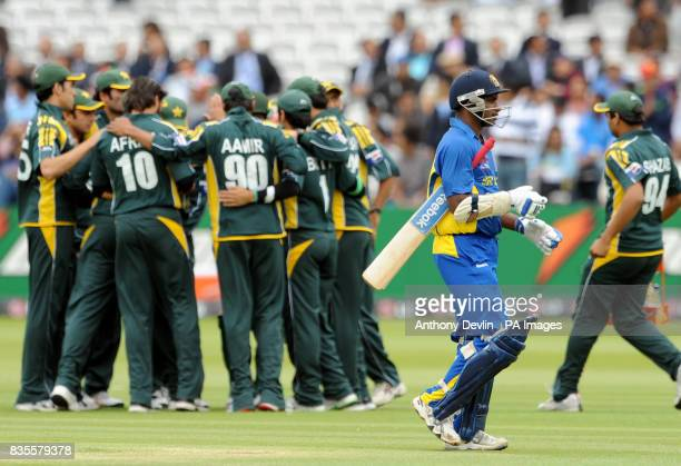 Sri Lanka's Sanath Jayasuriya leaves the field after being caught by Pakistan's Younis Khan off the bowling of Shahid Afridi during the ICC World...