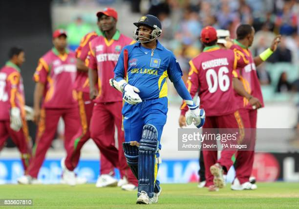 Sri Lanka's Sanath Jayasuriya leaves the field after being caught by Jerome Taylor during the ICC World Twenty20 Semi Final at The Oval London