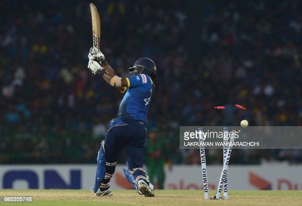 Sri Lanka's Seekkuge Prasanna gets dismissed by Bangladesh's Mashrafe Mortaza during the second T20 international cricket match between Sri Lanka and...