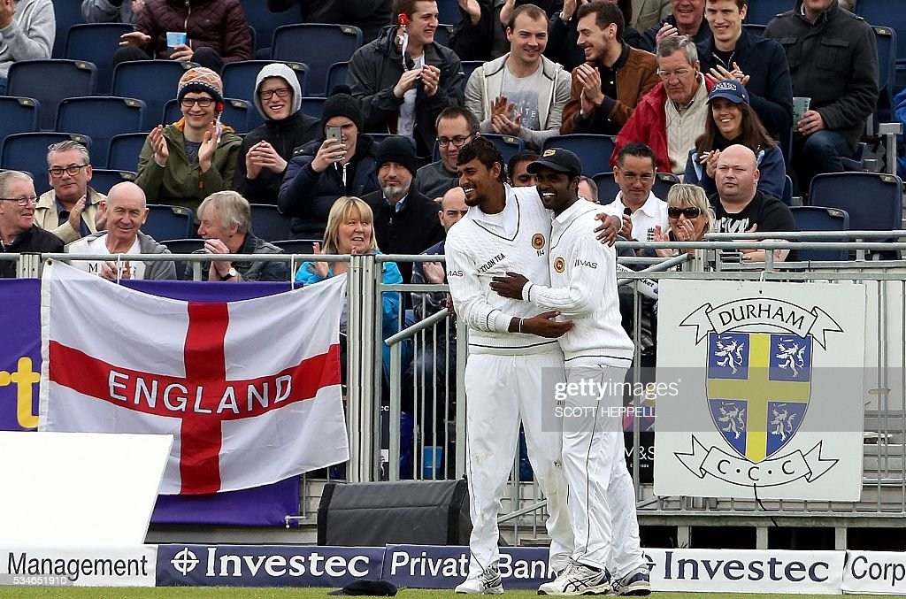 Sri Lanka's Suranga Lakmal (L) celebrates catching out England's Nick Compton for nine runs on the first day of the second Test cricket match between England and Sri Lanka in Chester-le-Street, north-east England on May 27, 2016. / AFP / SCOTT