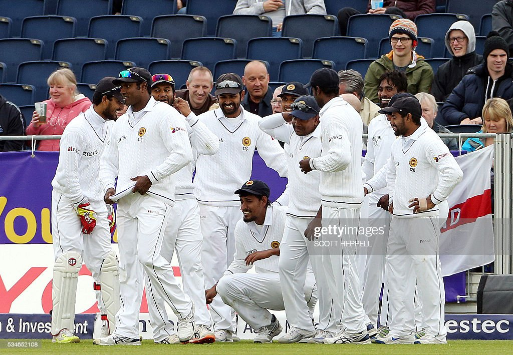 Sri Lanka's Suranga Lakmal (C) is congratulated by teammates after taking the wicket of England's Nick Compton for nine runs on the first day of the second Test cricket match between England and Sri Lanka in Chester-le-Street, north-east England on May 27, 2016. / AFP / SCOTT