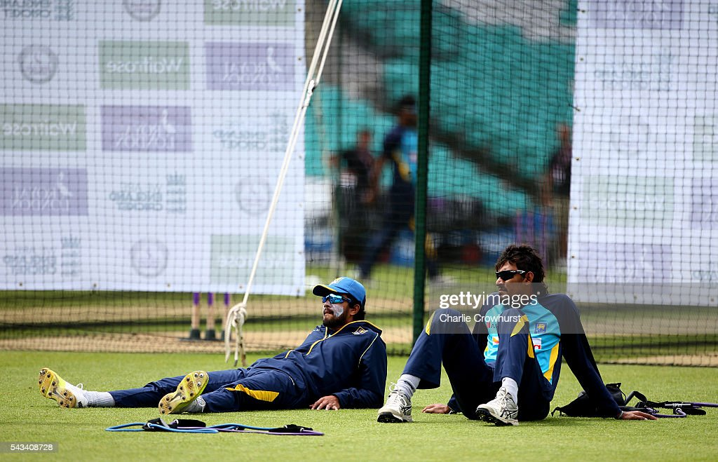 Sri Lanka's Suranga Lakmal (R) relaxes with Dinesh Chandimal (L) during an England & Sri Lanka Nets Session at The Kia Oval on June 28, 2016 in London, England.