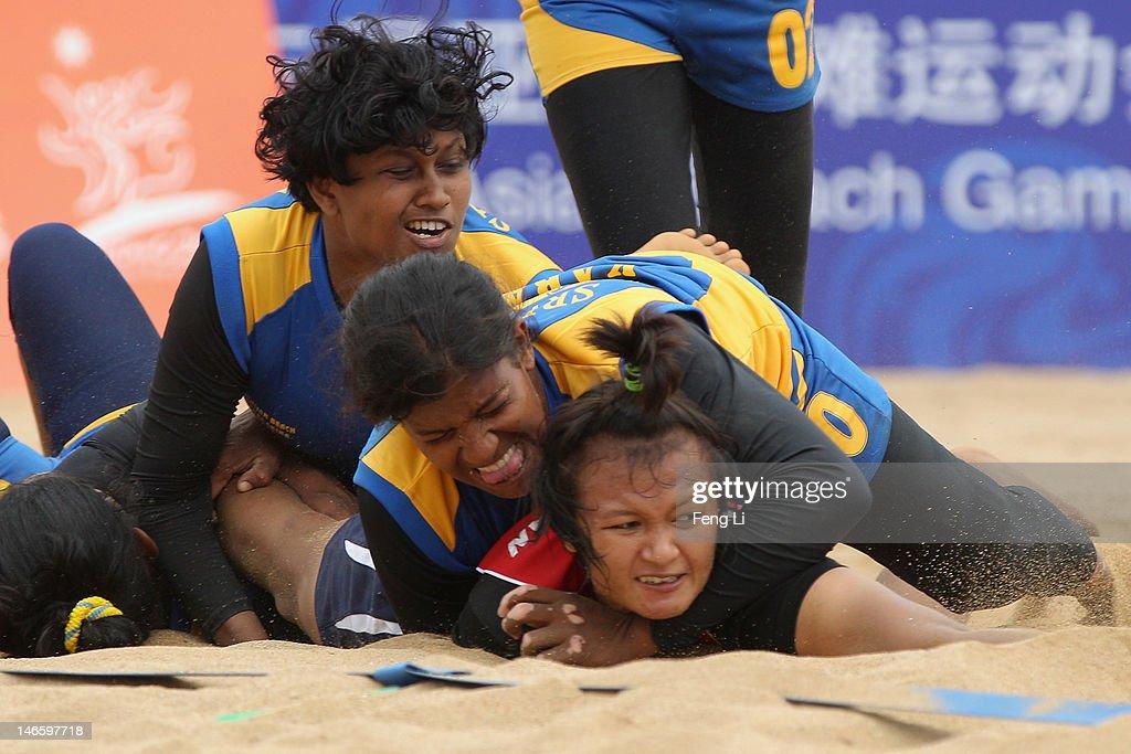 Sri Lanka's team take down Thailand's Tanatporn Srijan during the Beach Kabaddi Women's Team Group A match between Thailand and Sri Lanka on Day 4 of the 3rd Asian Beach Games Haiyang 2012 at Fengxiang Beach on June 20, 2012 in Haiyang, China.