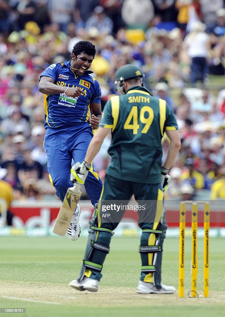 Sri Lanka's Thisara Perera (L) jumps in the air after dismissing Australia's batsman Steven Smith (R) during their one-day international cricket match at the Adelaide Oval on January 13, 2013. AFP PHOTO / David Mariuz USE