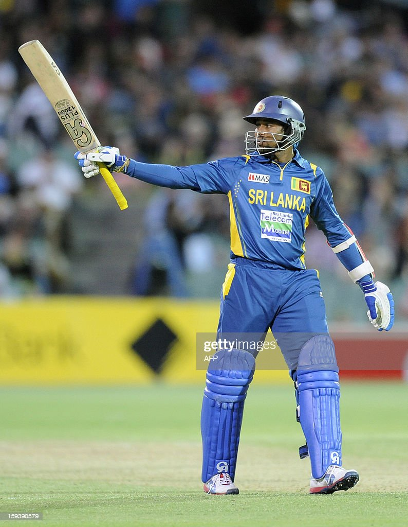 Sri Lanka's Tillakaratne Dilshan celebrates his 50 runs against Australia during their one-day international cricket match at the Adelaide Oval on January 13, 2013. AFP PHOTO / David Mariuz USE