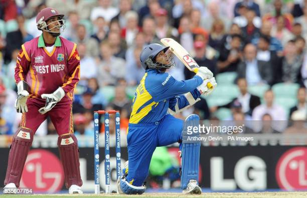 Sri Lanka's Tillakaratne Dilshan hits a boundary during the ICC World Twenty20 Semi Final at The Oval London