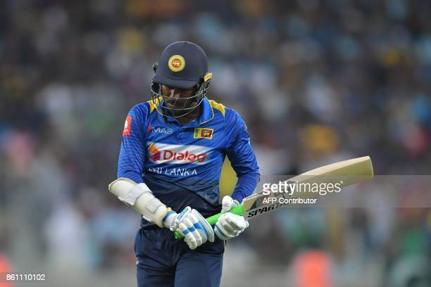Sri Lanka's Upul Tharanga leaves the field after being dismissed by Pakistan's Muhammad Hafeez during the first one day international cricket match...