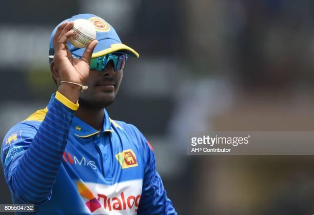 Sri Lanka's Wanidu Hasaranga celebrates after dismissing Zimbabwe's Tendai Chatara during the second oneday international cricket match between Sri...