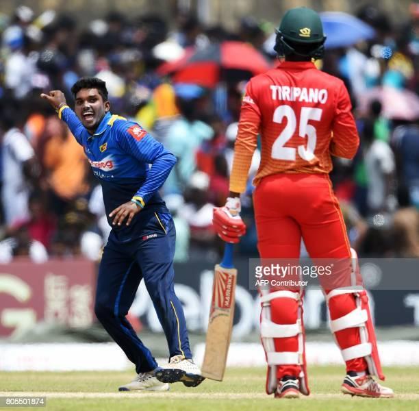 Sri Lanka's Wanidu Hasaranga celebrates after he dismissed Zimbabwe's Donald Tiripano during the second oneday international cricket match between...