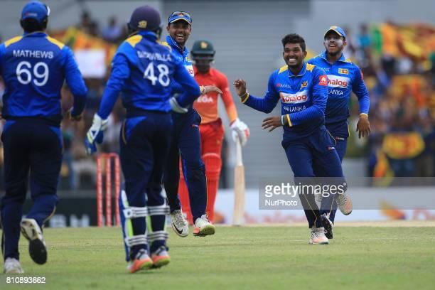 Sri Lanka's Wanidu Hasaranga celebrates with his team mates Sri Lankan/Zimbabwe cricketer during the 4th One Day International cricket matcth between...