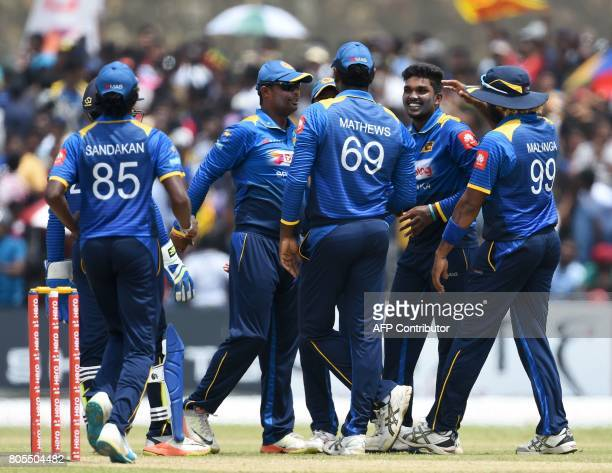 Sri Lanka's Wanidu Hasaranga celebrates with his teammates after he dismissed Zimbabwe's Donald Tiripano during the second oneday international...