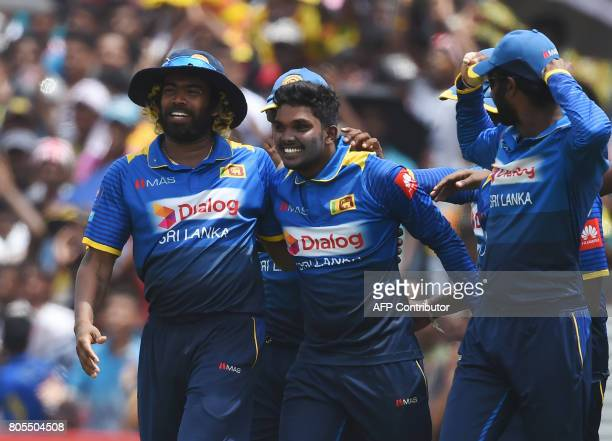 Sri Lanka's Wanidu Hasaranga celebrates with his teammates after he dismissed Zimbabwe's Tendai Chatara during the second oneday international...