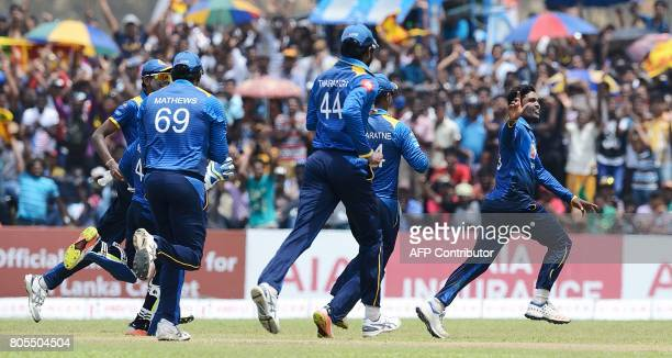 Sri Lanka's Wanidu Hasaranga celebrates with his teammates he dismissed Zimbabwe's Tendai Chatara during the second oneday international cricket...
