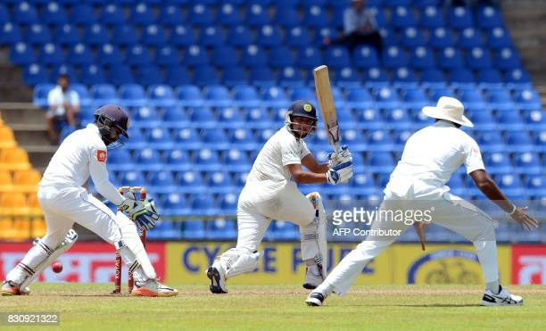 Sri Lanka's wicketkeeper Niroshan Dickwella reacts as India's Kuldeep Yadav plays a shot during the second day of the third and final Test match...