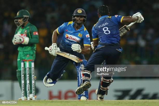 Sri Lanka'sKusal Perera and Asela Gunaratne avoid a collision as they run between the wickets during the first T20 international cricket match...