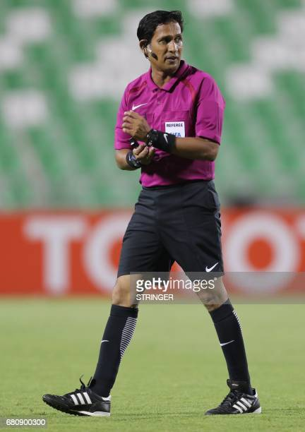 Sri Lanki referee Chishantha Dilan Perera walks on the pitch during the Asian Champions League football match between Iran's Esteghlal FC and Saudi...