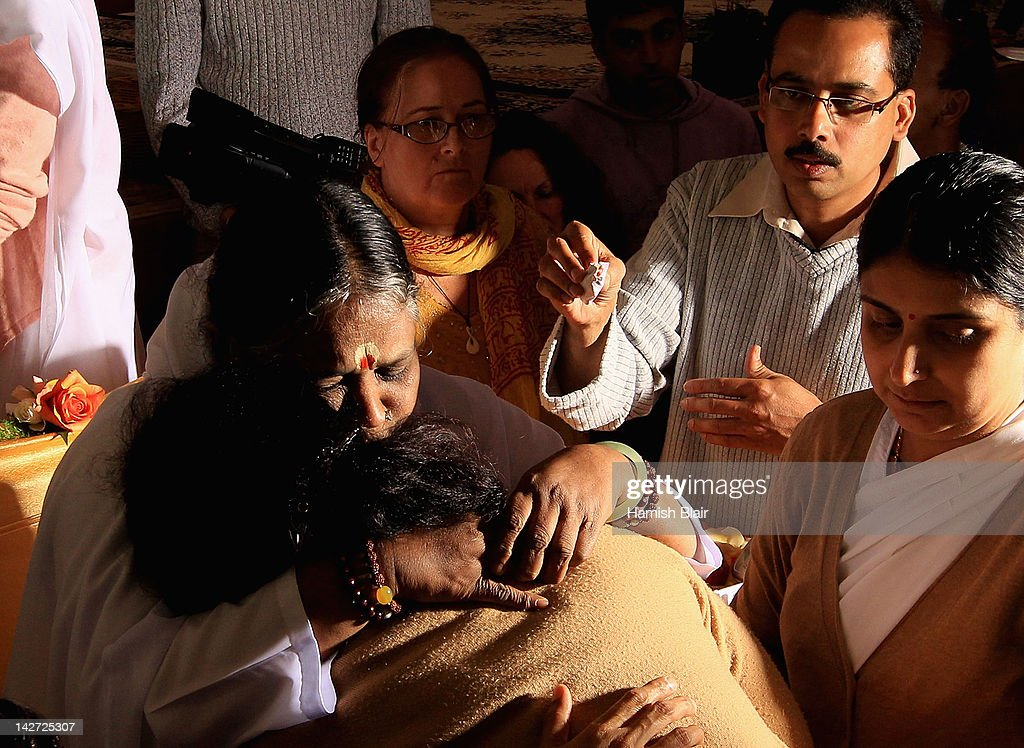 Sri Mata Amritanandamayi Dev, known as 'Amma' (mother) hugs a visitor on the first day of her Melbourne retreat on April 12, 2012 in Melbourne, Australia. The Hindu spiritual leader is known as the 'hugging saint' by her followers and is globally respected as a humanitraian. She will be conducting retreats and a series of free public programs during her Australian tour.