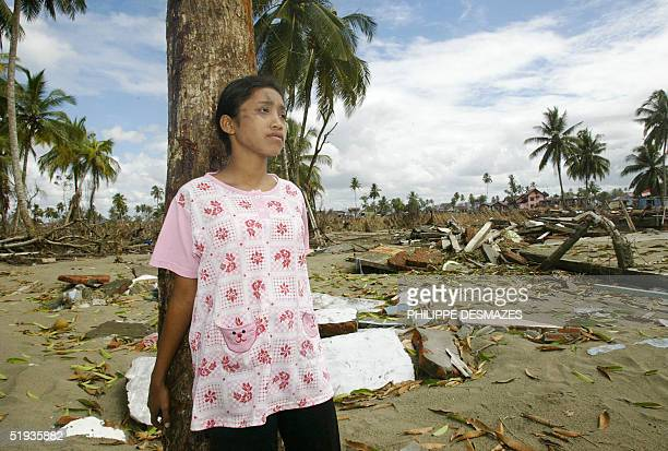 Sri Rezeni is coming back to the tree where she had taken refuge when the tsunamis made land following a strong 90 earthquake in Meulaboh Aceh...