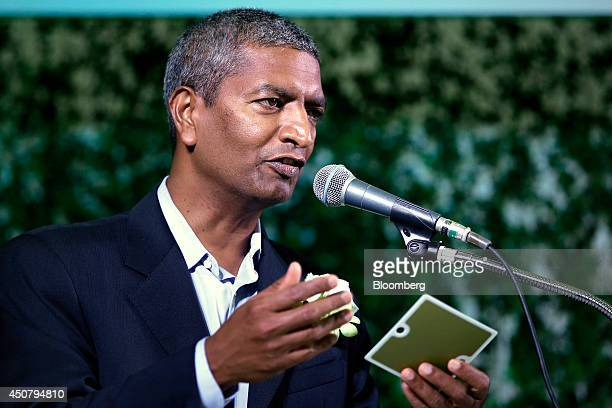 KR Sridhar cofounder and chief executive officer of Bloom Energy Corp holds a fuel cell for the company's Bloom Energy Server during the launch of...