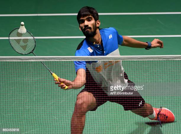 Srikanth Kidambi of India hits a return against Hu Yun of Hong Kong during their men's singles second round match at the Japan Open Badminton...