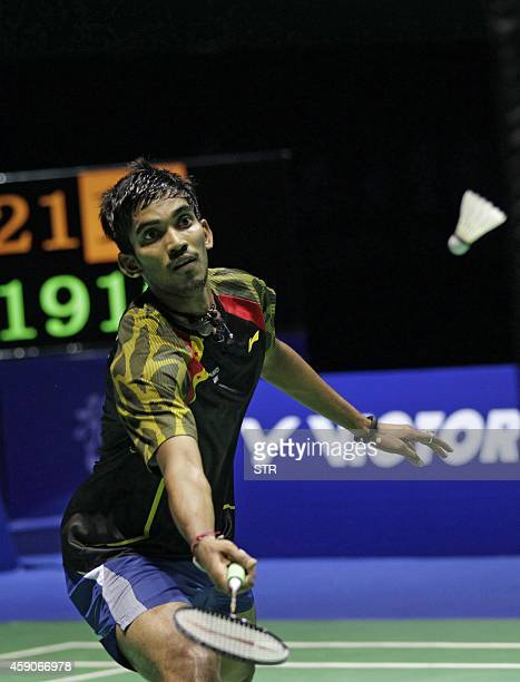 K Srikanth of India hits a return against Lin Dan of China during the men's singles title match at the Badminton China Open in Fuzhou China's Fujian...