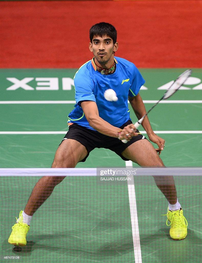 K Srikanth of India returns a shot to Tanongsak Saensomboonsuk of